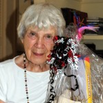 Yvonne Dollar with a pet gift basket